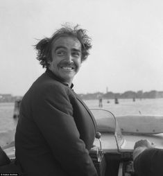 Glamorous vintage photographs show Venice has always had celebrity pulling power - A dishevelled Sean Connery rides a water taxi with the wind is his hair, overlooking the Venetian lagoon in the Marcello Mastroianni, Kirk Douglas, Roger Moore, Sean Connery, Paul Newman, Catherine Deneuve, Mick Jagger, Sophia Loren, Claudia Cardinale