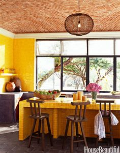 "Doing the kitchen in one color tile breaks with the Mexican tradition of having ""a riot of colors,"" designer John Houshmand says of his Mexican hacienda house."