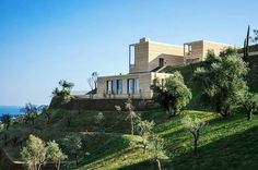"""Open up towards the #Mediterranean #landscape, #architect @David.Chipperfield designs two #villas on the hillside overlooking the resort town of Gardone Riviera, #Italy. Carefully inserted into the landscape with its olive groves and cypress #trees, the #typology of the villas interprets the architecture of the """"limonaia""""-traditional Lemon house. With #materials influenced by the region, the #buildings are made of natural stone masonry contrasting the green landscape. The two villas are…"""