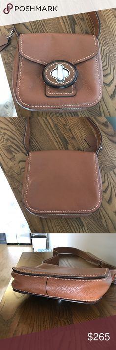"""EUC Coach leather purse with buckle This is by far the cutest Coach purse I have ever purchased.  This is a soft brown leather with a cute exclusive buckle lick.  The inside has 3 separate compartments, with 1 snap and 1 zip pocket.  The dimensions are 10"""" x 8.5"""" x 2.5"""" with a 45"""" adjustable strap.  This is from a smoke free home Coach Bags Shoulder Bags"""