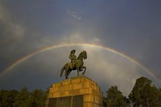 Image: A rainbow forms over the statue of Louis Botha, the first Prime Minister of the Union of South Africa, at Union Buildings in Pretoria.