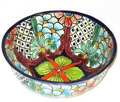 Round Talavera Bowl, imaginatively decorated with classic Mexican patterns. It can be the special addition to your ceramic collection that you have been searching for your home. Produced by F. Dorga in Mexico.