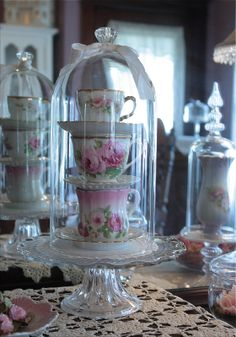 Vintage tea cups stacked in a glass cloche Tea Cup Saucer, Tea Cups, Tea Cup Display, Cloche Decor, The Bell Jar, Bell Jars, My Cup Of Tea, Rose Cottage, Apothecary Jars