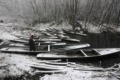 A Kashmiri man walks over snow covered boats during the season's first snowfall on a cold winter morning in Srinagar Picture: REUTERS/Danish...