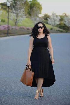 Tanesha awasthi black high short dress, brown tote, metalic sandals