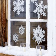 Love these japanese paper snowflakes for windows! I'm going to try to make some - they won't look this good, but the idea is the same : )