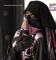 a beautiful niqabi muslim woman