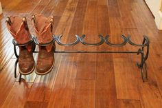 Custom made 3 Pair Horseshoe Boot Rack. This will hold three pairs of boots. Each boot rack will vary in size because we make them with used horseshoes. Great gift idea too! All our products Horseshoe Projects, Horseshoe Crafts, Horseshoe Art, Horseshoe Ideas, Horseshoe Boot Rack, Diy Shoe Rack, Shoe Racks, Custom Boots, Creation Deco