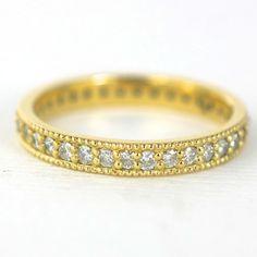 Custom, classic pave Diamond Eternity band. 18k yellow gold ring with diamonds. Custom wedding ring by Abby Sparks Jewelry, custom jewelry designer in Denver, Colorado.