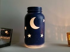 Moon and Stars Blue White with Silver Flecks Lighted Glass Jar Luminary Lantern for Tealights and Fairy Lights Tabletop Decor - Blackfriday Etsy Crafts With Glass Jars, Glass Bottle Crafts, Diy Bottle, Bottle Art, Glass Jar Decorations, Mason Jar Art, Mason Jar Crafts, Diy Crafts Vases, Diy Jars
