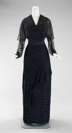 An elegant 1910-1912 dinner dress with gorgeous black on black fabric. Designed by Miss Beckie.