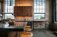 wood cabinets, brick wall, industrial, windows, kitchen, concrete floors, Andrea Beecher, cityhomeCOLLECTIVE