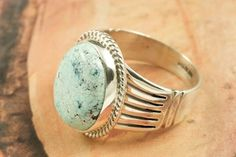 Genuine Blue Moon Turquoise set in Sterling Silver Ring. The Blue Moon Turquoise Mine is located in Esmeralda County, Nevada. It closed in the late 1970's. Blue Moon Turquoise is now obtained from private collections. Created by Navajo Artist Tony Garcia. http://www.treasuresofthesouthwest.com/turquoise-rings.html