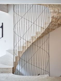 Helix in the center of spiral stair acting as guardrail I Décor Aid Design interior for minimalist home wall colour ideas