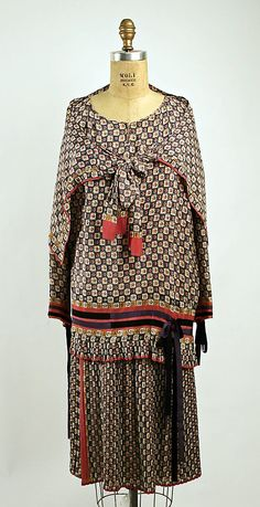 Ensemble Nellie Harrington (American) Date: 1928 Culture: American Medium: silk Dimensions: (a) Length at CB: 29 in. (73.7 cm) (b) Length at CB: 39 in. (99.1 cm) (c) Overall: 12 x 34 in. (30.5 x 86.4 cm) Credit Line: Gift of Mrs. Sidney Bernard, 1956 Accession Number: C.I.56.33.10a–c