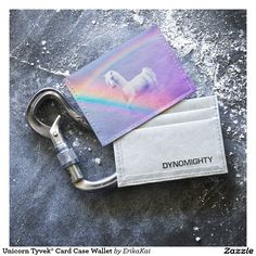 "Unicorn and Rainbow Dynomighty Tyvek® Card Case Wallet. Dimensions: 4"" x 2.91"" x 0.07"". 3 card pockets, 1 cash pocket. Color: grey, black or brown."