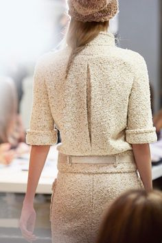 Chanel jacket in the classic tweed. With a pleat detail on the back which creates effect. I like the rolled sleeve.
