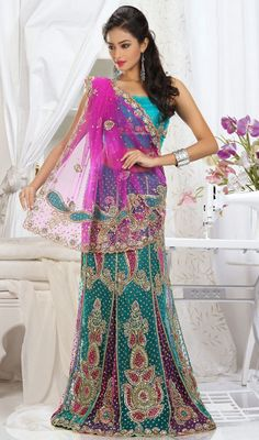 This designer pink and sea green net lehenga saree is designed in two tone panels which gives you a lehenga effect from the hem. It is designed in zardosi embroidery pattern with beads cutdana, moti, applique, resham or stone work all around with scattered butties and sequence. Saree edges are finished with decorative cut work. Saree comes with matching stitched blouse as shown in the picture. #BeautifulLehengaSarees #FashionLehengaSarees
