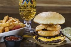Short Stack Burger – Single cheeseburger topped with beer-braised shredded short rib and stacked with crisp beer-battered onion rings – Metro Grill, Section 105