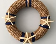 Browse unique items from ShabtiqueDesign on Etsy, a global marketplace of handmade, vintage and creative goods. Browse unique items from ShabtiqueDesign on Etsy, a global marketplace of handmade, vintage and creative goods. Coastal Wreath, Seashell Wreath, Nautical Wreath, Seashell Crafts, Beach Crafts, Summer Crafts, Lake Decor, Rope Crafts, Diy Wreath