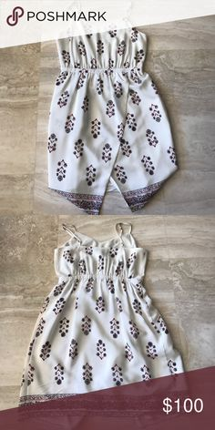 a flowery printed dress from madewell this dress is great for summer and perfect for brunch. It is a white color with a flowery design. The bottom of the dress has a paisley looking print along the bottom Madewell Dresses Mini