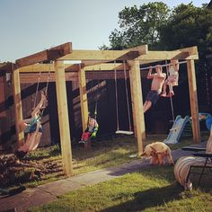 Our garden pergola / climbing frame with swings, monkey bars, trapeze bars and a pull up bar. Just need to grow some stuff up it now! Diy Pergola, Pergola Swing, Wooden Pergola, Pergola Shade, Pergola Plans, Pergola With Swings, Outdoor Pergola, Garden Swings, White Pergola