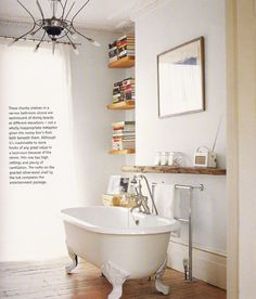 I see a bathtub, books & towel warmer...all I need is a side table with dark chocolate on it & it's perfect!