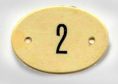 Bed Tag Used in First Class Bedrooms of Titanic    This synthetic ivory tag was recovered from the debris field by William Parker while on board the Minia recovering bodies. These tags were used to number beds in the First Class bedrooms.