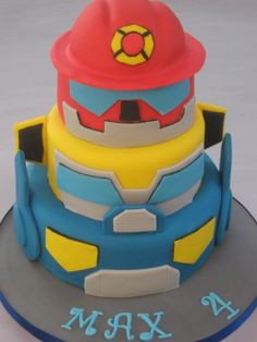 Three-tiered chocolate and vanilla sponge Rescue Bot cake.
