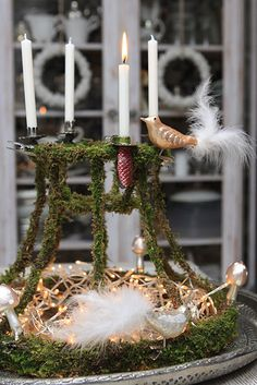 lampshade skeleton wrapped with moss to create gorgeous advent wreath