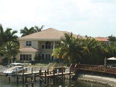 Sunbelt Home Plan Rear Photo 02 - Linda Vista Luxury Home Florida House Plans, Coastal House Plans, Luxury House Plans, Florida Home, Craftsman Bungalow House Plans, Craftsman Bungalows, Cabana, Italian Style Home, Tuscan Style Homes