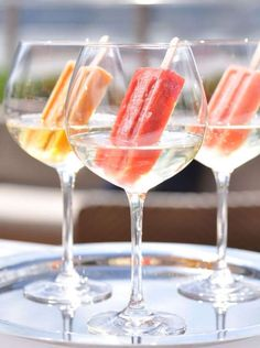 For a summer treat, drop a colorful ice pop into your glass of white wine. Just consider yourself wa... - Loopy