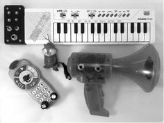 Figure 7-1: A selection of circuit-bent instruments and toys. Note the black box on the keyboard and the new bits on the other three: the knobs, switches, and bare metal contacts allow us to tinker with the toys' pitch and tone on the fly, while the jacks allow us to amplify the output (and, in the case of the megaphone, pump our own signal into the input).