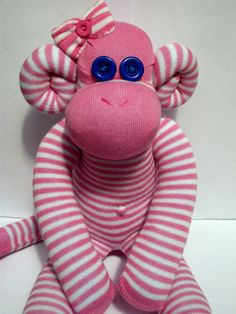 Sweet Monkey in candy-stripe. Sockamajigs with a bow are £15 plus p+p.