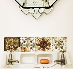 I love the sink with the wall alcoves for soap, and I also love the use of the antique tiles