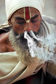 Sadhu in India are people who have denounced society and living within its norms. Many of these men indulge in intoxicants, including smoking pot.