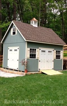 """14'x16' Two-Story Garden Shed with Transom Windows in Doors, 30""""x36"""" Windows, Cupola, and Ramp http://www.backyardunlimited.com/sheds.php"""