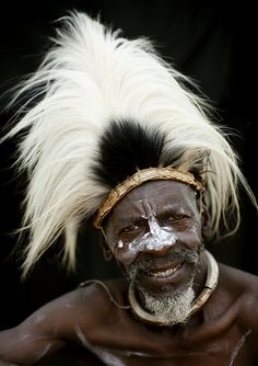 Africa |  Mister Kirimi, Tharaka tribe chieftain - Kenya.  He is wearing a headdress made with a colobus monkey skin tail.  © Eric Lafforgue