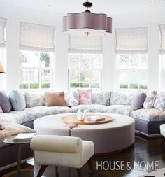Large Eat-in Kitchen Banquette | Bold furnishings, exuberant colour and clever architecture make up this beautiful home designed by Katherine Newman. Learn how artfully layered patterns and textures lend a playful but sophisticated feel that's perfect for a family with children: http://houseandhome.com/tv/segment/how-decorate-colour-and-pattern