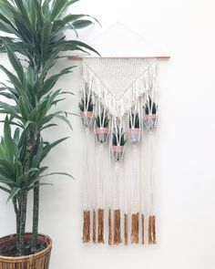 A lovingly handmade 5 mini pot plant hanger. The copper pipe measures 56cm wide, macrame approx 41cm wide by 102cm long.  Pots not included.  Other designs and options are available, please see other listings or contact me with a custom request. Thank you.
