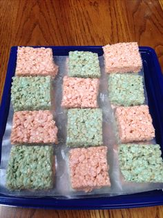 Pink and blue Rice Krispie treats as a dish for Baby Gender Reveal party