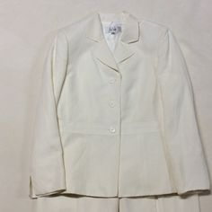 Le Suit pant suit LE Suit cream linen and rayon pantsuit. Jacket is a 10 pants are a 12. Right leg has very small spot which would probably come out with cleaning. Le Suit Other