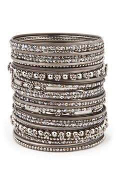 Cara Accessories The More the Merrier Bangle Set - Available in both gold and silver this enormous stack of bangles will make you look like you paid a pretty penny, when in reality they'll only set you back $8!!!
