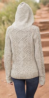 This boxy-fit women's cardigan hoodie features a large cable panel on the back, with matching cables down the front openings and the hood, as well as on the raglan sleeves. The body is knit from the bottom hem up to the armholes, where the sleeves are then joined and the remainder of the cardigan, including the hood are worked in one piece to the top. It is finished with a zippered closure for a casual, sporty look.