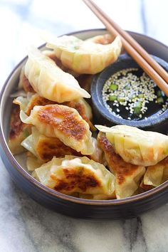 Shrimp Gyoza - amazing Japanese gyoza dumplings filled with shrimp and cabbage. Crispy, juicy and so easy to make at home. from @rasamalaysia
