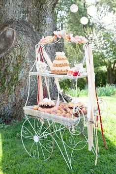 Vintage Flower Cart With Desserts   photography by http://cynkainphotography.com/ Love the idea of a decorated cart, or baker's rack with desserts.