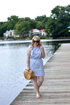Fourth of July Outfit Idea: Chambray ruffle dress, bamboo bag, sandals and red lipstick.