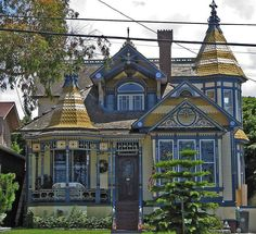 Mock Queen Anne - This house in Redondo Beach, California began as a bungalow but was remodeled to look like a Queen Anne Victorian. Not much of the original structure remains.  Odd!