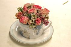 Our sweet tea-cup posy sits pretty in the Laura Ashley Rose Hill China Cup and Saucer.