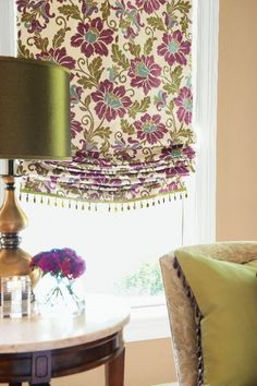 How to do florals for window treatments. A relaxed roman shade blind in a modern floral pattern adds a pop of colour at a living room window. Contemporary Roman Blinds, Relaxed Roman Shade, Custom Window Treatments, Custom Windows, Curtains With Blinds, Valances, Burlap Curtains, Window Styles, Fabric Shades